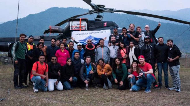 Nepal skydive over the himlayas with gobeepbeep group photo with helicopter