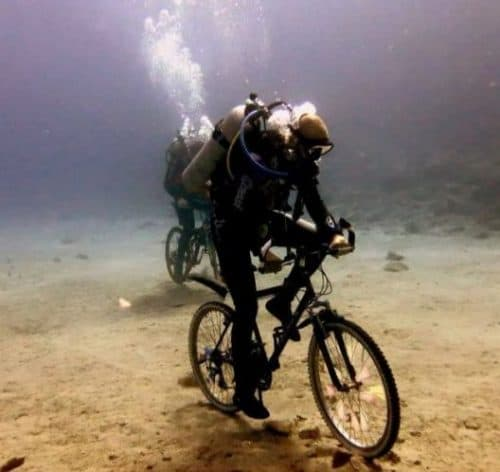 Underwater cycling while scuba diving